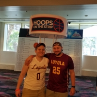 Two alums cheering on the Ramblers in the first round from Vegas.