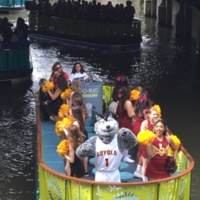 The band and cheerleaders on the river.
